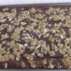 Fudge Nut Oatmeal Bars - Sliced almonds and almond extract give these chocolatey oatmeal bars an extra nutty flavor.
