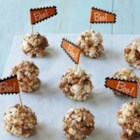 Butterfinger Popcorn Balls - This recipe's 'hands-on' preparation is a thrill for kids and results in a sweet and chewy combination of chopped Butterfinger, crunchy popcorn and miniature marshmallows.