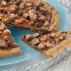 Candy Shop Pizza - Kids and adults will delight as they bite into this Candy Shop Pizza. The chewy chocolate chip cookie base is topped with creamy chocolate morsels, chunky peanut butter, and an assortment of chopped candy. This delicious treat also provides the perfect way to use up those trick-or-treating leftovers!