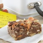 Easy No-Bake Butterfinger(R) and Peanut Butter Pretzel Bars - With milk chocolate morsels, pretzels, peanut butter and Nestlé(R) Butterfinger(R) candy pieces, these no-bake bars are the perfect sweet and salty treat both kids and adults can enjoy!