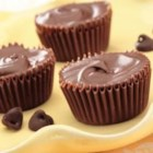 Frozen Butterfinger Cups - These versatile and adorable Frozen Butterfinger Cups are perfect treats for any occasion. Great as a dessert plate to be passed around or for a featured item on a dessert buffet. Kids and adults alike will love these tiny treats.