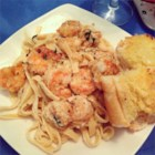 Absolutely The Best Shrimp Scampi - Shrimp sauteed in olive oil, with a brandy sauce flavored with garlic shallots and oregano. Great served with a rice pilaf and salad!