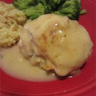 Gina's Crab Stuffed Chicken Breast - Chicken breasts are stuffed with crab, baked in a cream sauce, then topped with cheese-yum!