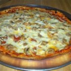 Pizza On The Grill II - This is pizza made on a gas grill. The results are great, and plenty of variations would work. The trick is to grill one side of the pizza dough first, then add the toppings.