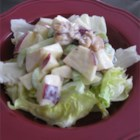 Simple Waldorf Salad - Who doesn 't love this terrific salad. Apples, celery, raisins and walnuts are all folded into a mayonnaise/vinegar dressing and then chilled. Real comfort food.