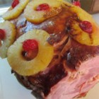 Grandma's Ham - This recipe for roasting a whole ham uses pineapple, maraschino cherries, and ginger ale.