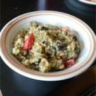 Pesto Quinoa - Quinoa is cooked in chicken broth, seasoned with pesto, and mixed with fresh tomato in this Ecuadorian side dish.