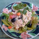 Delicious Macaroni Salad - A classic macaroni salad contains ham, dill pickle relish, and black olives in a creamy mayonnaise dressing flavored with Dijon mustard.