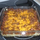 Hamburger Hash Browns - A homemade hash brown crust is topped with seasoned ground beef and Cheddar cheese for a quick and easy comfort-food dish.