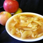 Apple Pie Filling - When your favorite apple is in season, pick up a bunch and make this luscious pie filling that freezes beautifully. Sliced apples are partially cooked on top of the stove with water, sugar, cornstarch, cinnamon and nutmeg. Then they 're ladled into containers and frozen. You 'll have enough for five 9-inch pies.