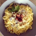 Aphrodisiac Tagliatelle with Blue Cheese Sauce - Tagliatelle, that tender, flat Italian noodle related to fettuccine, gets a simple blue cheese cream sauce and a sprinkle of toasted walnuts for a fast but romantic pasta dish.