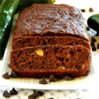 Chocolate Chip Zucchini Bread - Moist chocolate zucchini bread is full of chopped nuts and chocolate chips. Nobody will guess this easy treat is made with a green veggie. Recipe makes 2 loaves.