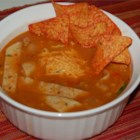 Tortilla Soup III - Sauteed ground beef and onions are added to a spicy chicken broth seasoned with cumin, chili powder and cayenne in this recipe which uses canned cream corn, processed cheese, and corn tortilla strips.