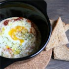 Chef John's Baked Eggs - Eggs are baked in a spicy marinara sauce and topped with cream and Parmigiano-Reggiano, for a rich and creamy brunch dish.