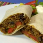 Black Bean and Rice Burritos - Tasty burritos are filled with black beans and rice and can be garnished with your favorite toppings, including Cheddar and Monterey Jack cheeses, lettuce, and sour cream. They're easy on the budget.