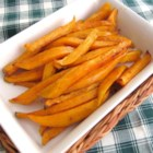 Sweet and Spicy Sweet Potato Baked Fries! - Baked sweet potatoes are coated in honey and cayenne pepper for a sweet and spicy snack or burger accompaniment. Serve with honey mustard.