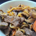 Beef Sukiyaki - Vegetables, noodles, and beef are served in a steaming, flavorful broth made with dashi, mirin, and soy sauce in this Japanese dish, sukiyaki.