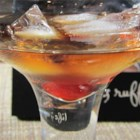 Cancun Martini - Tequila shaken with coffee-flavored liqueur produce a Mexican-inspired cocktail. Garnish with a maraschino cherry for  a fun accent.