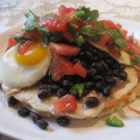 "Black Bean Huevos Rancheros - Layered with black beans along with fresh salsa and shredded Monterey Jack cheese, this is a delicious version of the classic Spanish or Mexican ""rancher's eggs"" dish."