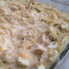 Tarragon Chicken Casserole - Tarragon cream sauce graces this chicken and spaghetti casserole, topped with a scattering of Parmesan.