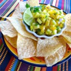 Apple Mango Salsa - A crunchy salsa comes together with diced mango, apple, cucumber, and yellow bell pepper. Toss with lime and orange juice, cilantro, and jalapeno for a tangy side dish.