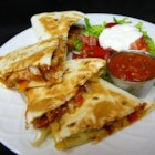 Texas Chicken Quesadillas - These are quesadillas filled with chicken cooked in barbeque sauce, caramelized onions, Cheddar and Monterey Jack. Serve with plenty of guacamole, sour cream and chunky salsa!