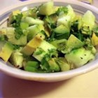Tangy Cucumber and Avocado Salad - A great, fresh-tasting picnic salad, it combines avocados, cucumbers, garlic, and green onions with chopped cilantro and the bright flavors of lemon and lime juice.