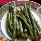 Honey Ginger Green Beans - Fresh green beans simmer in honey and soy sauce, fragrant with fresh garlic and ginger, in this easy side dish.
