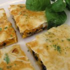 Black Bean and Sweet Potato Quesadillas - Mashed sweet potatoes, black beans, and Cheddar cheese are sandwiched between two tortillas for a tasty vegetarian appetizer that even meat-eaters will like.