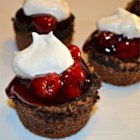 Black Forest Cheesecakes - A Yuletide treat, these easy mini-cheesecakes combine the perfect match of chocolate and cherries.