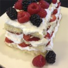 Angel Cake with Strawberries & Citrus Cream - Naturally luscious whipped cream spiked with fresh-tasting citrus dresses up Angel Food cake and strawberries with ease. Toasting the cake enhances the flavor and texture.