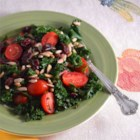 Kale Salad - Hearty kale makes a delicious green salad with sunflower seeds and dried cranberries.