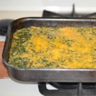 Spinach Casserole - This creamy spinach topped with Cheddar cheese is sure to be a hit at holiday gatherings.