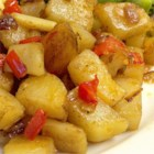 Herbie's Home Fries - This simple potato, onion and green bell pepper dish goes well with nearly everything! We suggest serving it alongside your favorite meatloaf. Hungarian paprika is the secret taste sensation in this recipe!