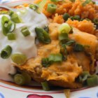 Enchiladas Suizas - Corn tortillas rolled up with shredded chicken and 2 kinds of cheese, and then served with a zesty salsa verde. This dish can also be made with cooked pork or beef.