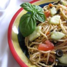 Nancy's Spaghetti Salad - Spaghetti is tossed with a variety of vegetables and Cheddar cheese and flavored with Italian dressing for a filling lunch or hearty side dish.