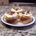 Cinnabon(R) Cupcakes - If you love cinnamon rolls and you love cupcakes (and who doesn't?) you will love this recipe for cinnamon-flavored cupcakes topped with fluffy frosting and a pinch of candied pecans.