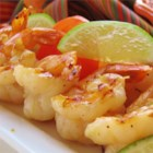Grilled Tequila-Lime Shrimp - Shrimp seasoned with a zesty lime-tequila marinade flavored with garlic, cumin, and ground black pepper are grilled on skewers for a tasty appetizer.