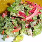 Kale Slaw - Robust kale makes a colorful and tasty slaw when combined with shredded carrot, red onion, and bacon in a simple citrus dressing.