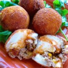 Papas Rellenas (Fried Stuffed Potatoes) - Garlic, cumin, and tomato flavor the beef filling inside these stuffed potato balls.