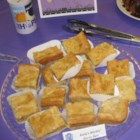 Southern Chess Squares - A yellow cake and pecan crust is topped with a rich cream cheese filling, then cut into squares for easy serving.