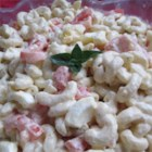 Tomato and Macaroni Salad - Macaroni and the summer's ripest tomatoes combine in an easy and refreshing pasta salad with a mustard-mayonnaise dressing.
