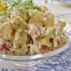 Southern Dill Potato Salad - Dijon mustard, cider vinegar, and celery salt add flavor to a tangy dill dressing that coats chunks of red potatoes and hard-boiled eggs.