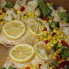 Healthier Easy Baked Tilapia - Tilapia is quick and easy to prepare. This flavorful dish uses fresh garlic and lemon to highlight the natural flavor of the fish. Accompanied by cauliflower, broccoli, and red pepper - you have a colorful and satisfying meal.