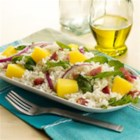 California Rice Salad - Great for a pot luck, picnic, or a barbecue, this rice salad with pineapple, arugula, and crumbled bacon will be a favorite.