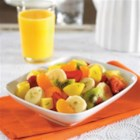 Honey Lime Fruit Toss - Pineapple chunks, mandarin oranges, bananas, and more are tossed in a lime and honey dressing for a delicious dessert or snack.