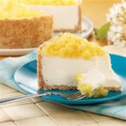 Pina Colada Cheesecake - The pineapple, rum, and coconut flavors of your favorite cocktail are mixed into this creamy, delicious cheesecake.