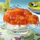 Pineapple Orange Fruit Mold - Peach gelatin with chunks of pineapple has a base layer of creamy whipped topping when it's unmolded for this pretty dessert or side salad.