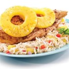 Pineapple Spiced Chicken and Rice - Chicken pieces are coated with a richly seasoned herb and spice rub, baked with pineapple slices, and served over pineapple jasmine rice.