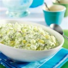Watergate Salad from DOLE(R) - This dessert salad with a pistachio pudding base contains crushed pineapple, miniature marshmallows, pecans, and whipped topping.